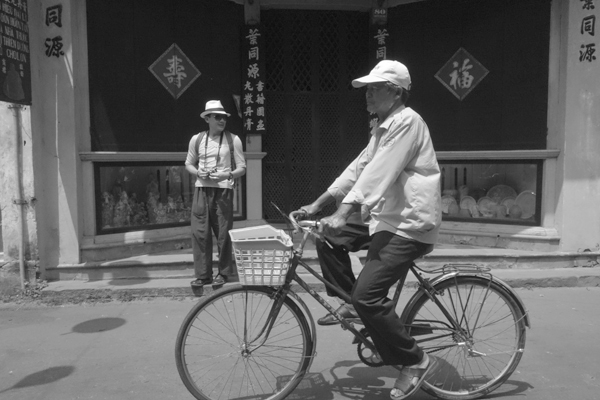Wearing a cap on a bike. Hoi An, Vietnam 2016.