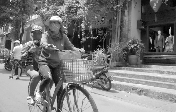 Sharing a bike with luggage. Hoi An, Vietnam 2016.