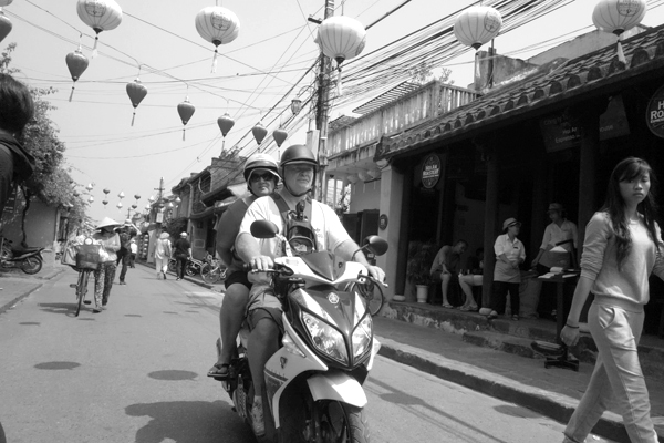 Sharing a scooter. Hoi An, Vietnam 2016.