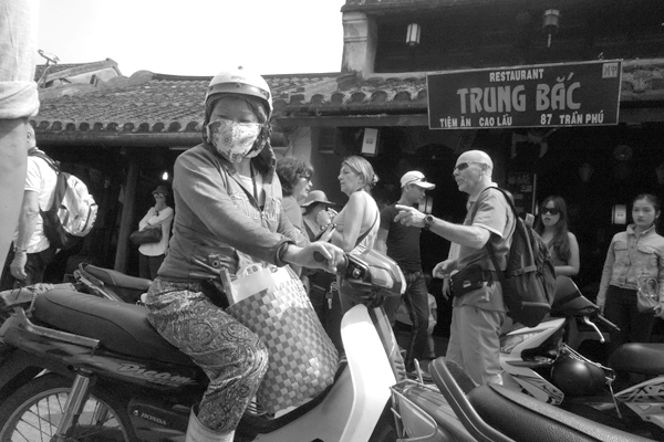 Wearing a mask. Hoi An, Vietnam 2016.