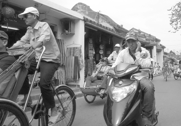 Motorcyclist & rickshaws. Hoi An, Vietnam 2016.