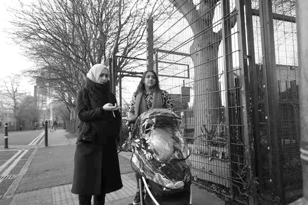 Conversation in Buxton Street. Spitalfields 2017.
