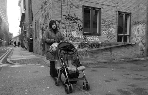 Woman with pushchair on Buxton Street. Spitalfields 2017.