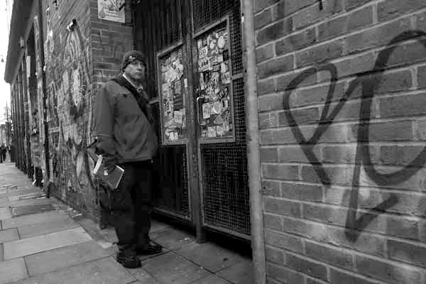 Postman on Buxton Street. Spitalfields 2017.