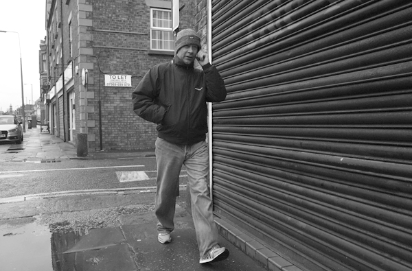 On the phone in Wavertree High Street. Liverpool January 2018.