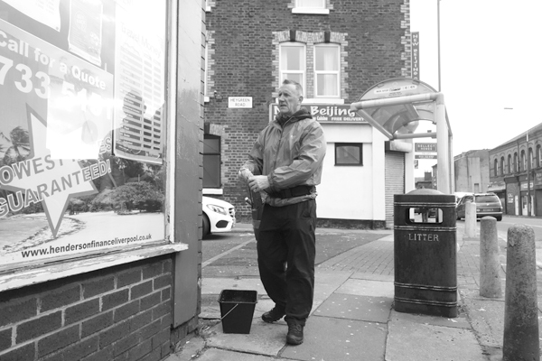 Window cleaner on Picton Road. Liverpool, January 3rd 2018.