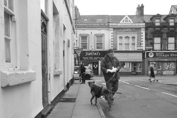 Man with a dog on Sandown Lane. Liverpool, January 3rd 2018.