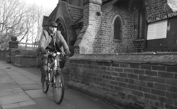 Cyclist passing the Wellington Road Mission. Liverpool, January 4th 2018.