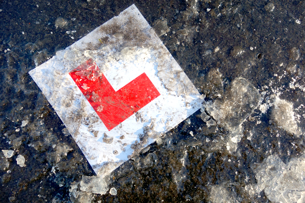 Learner plate trapped in ice on the path in Wavertree Park. Liverpool January 7th 2018.