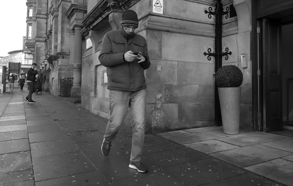 Man on a phone in Lime Street. Liverpool January 2018.