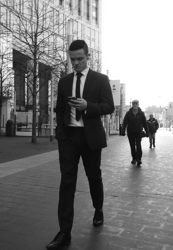 Man on a phone in Liverpool One. Liverpool January 2018.
