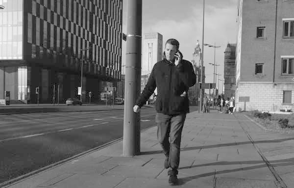 Man on a phone. Liverpool January 2018.