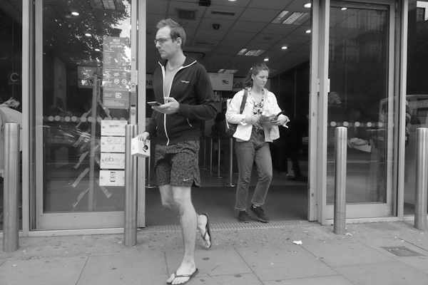 Emerging from a shop in Whitechapel. East London, September 2017.
