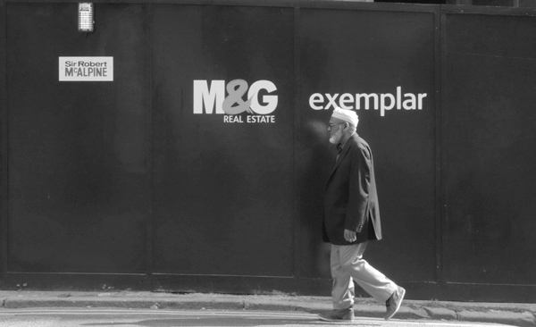 Passing a construction site in Spitalfields. East London, September 2017.
