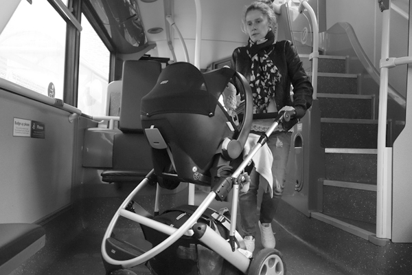 Woman with a pushchair on the bus. Liverpool, October 2017.