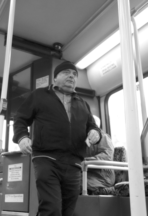 Man with a cap on the bus. Liverpool, October 2017.