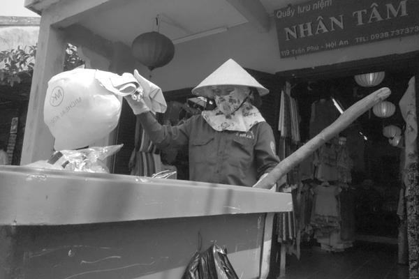 Street cleaner. Hoi An, Vietnam 2016.