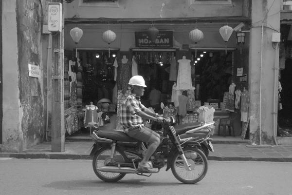 Motor cyclist. Hoi An, Vietnam 2016.