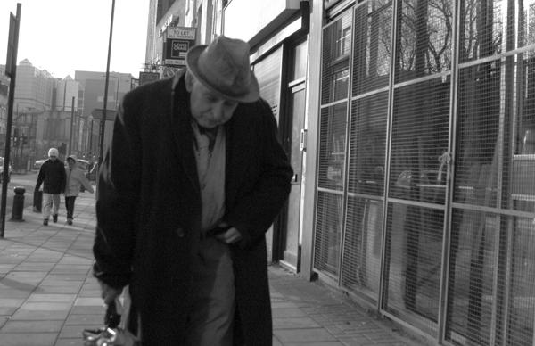 Man wearing a hat. Whitechapel High Street. East London 2002.