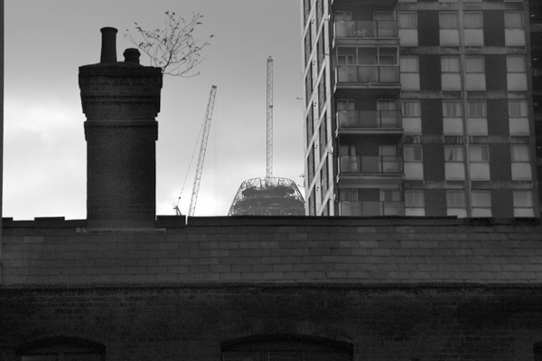View towards Denning Point from Toynbee Hall (most of which is now demolished to make way for luxury flats). East London 2002.