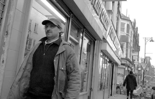 Man wearing a cap on Brick Lane. East London 2002.