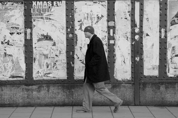Man wearing a woolen cap on Brick Lane. East London 2002.