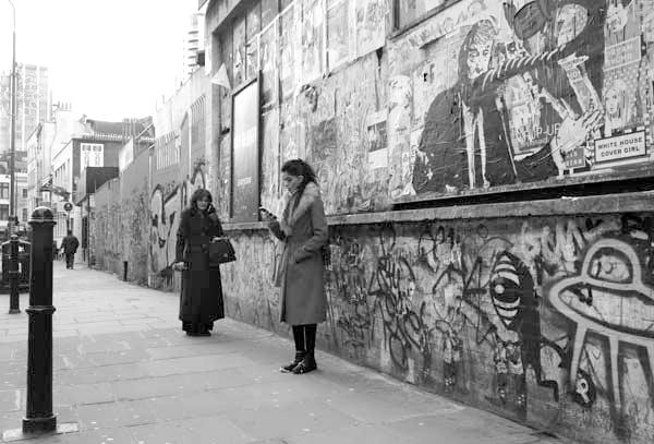 On the phone in Osborne Street. East London, December 2017.