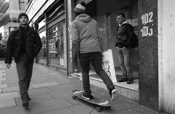 Skateboarder on Whitechapel High Street. East London, December 2017.