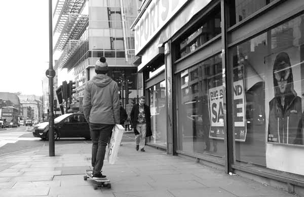 Skateboarder on Whitechapel High Street (2). East London, December 2017.