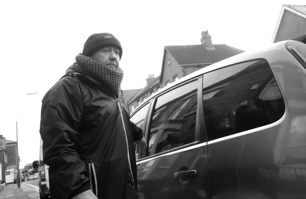 Man leaving his car on Picton Road, Liverpool January 2018.