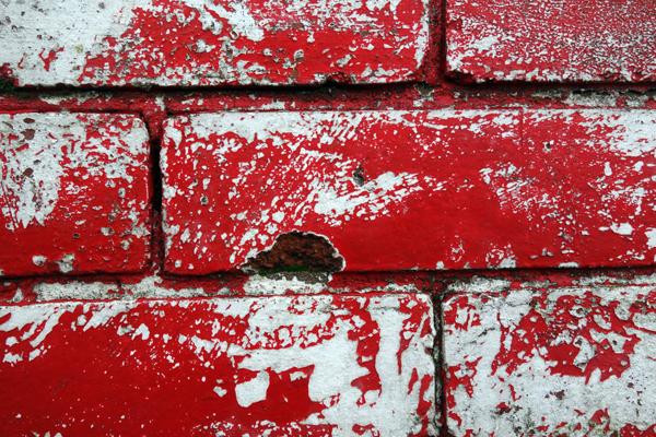 Bricks painted red on Wellington Road, Liverpool January 2018.