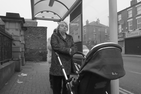 Waiting for the bus on Picton Road. Liverpool January 2018.