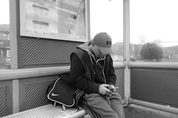 Waiting at a bus stop on Wellington Road. Liverpool January 2018.