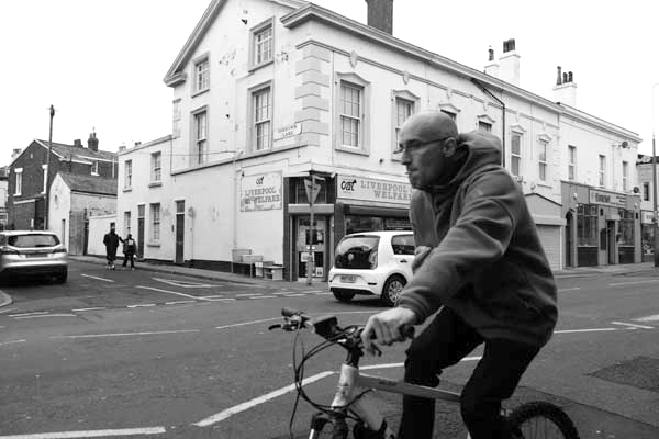Man on a bike on Picton Road. Liverpool January 2018.