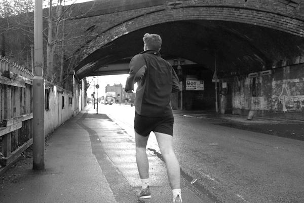 Man running on Wellington Road. Liverpool January 2018.