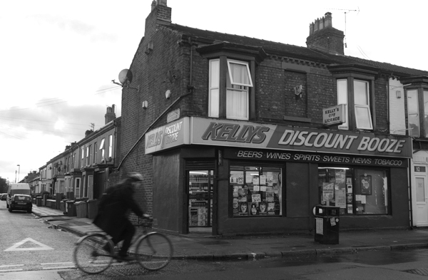Discount booze & a cyclist on Lawrence Road. Liverpool January 2018.