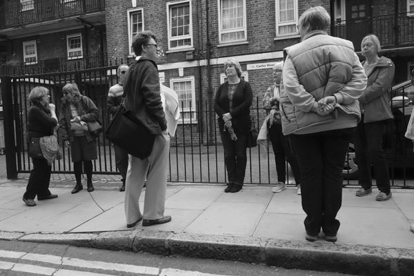 Tourists on a walk in Brune Street. East London, September 2017.