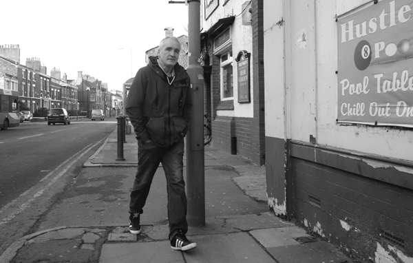 Man with his hands in his pockets. Wavertree High Street. Liverpool January 2018.