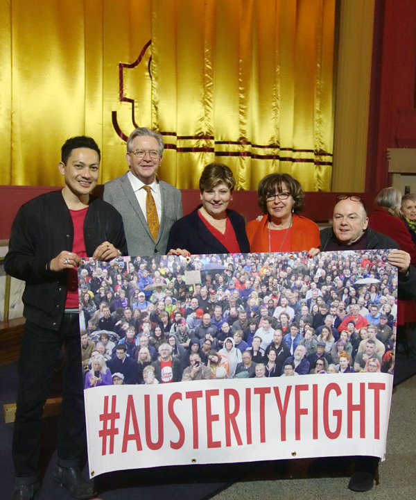 Holding the Austerity Fight banner.