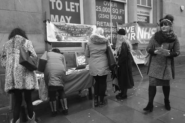 Petition signing against NHS cuts on Bold Street. Liverpool, February 2018.