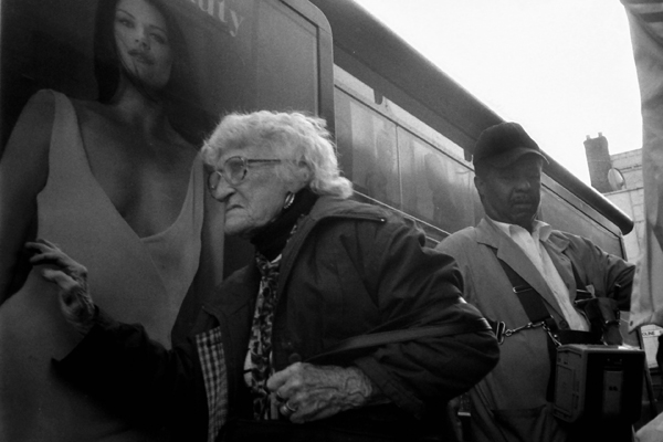 An old lady ends her journey on a route master bus.