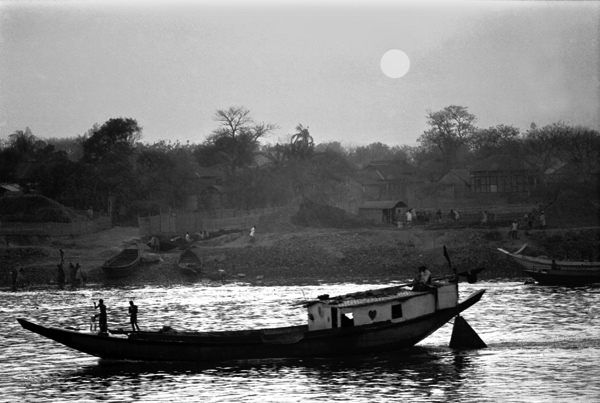 Buriganga river with a boat during sunset, 1992